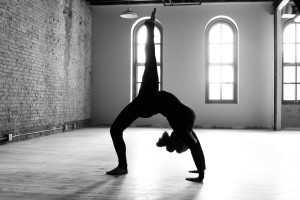 backbend-yoga-pose-with-leg-extended-black-and-white