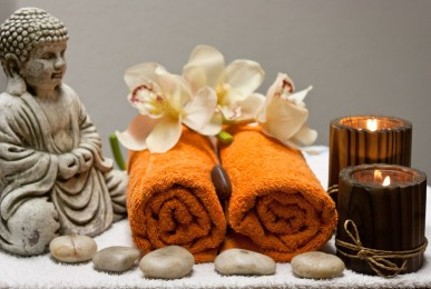 buddha-candle-towel-stones-orchids-massage-therapy
